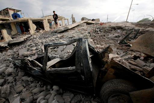 A flattened car is seen under the debris of a collapsed building, after an earthquake struck off the Pacific coast, in town of Canoa, Ecuador April 18, 2016