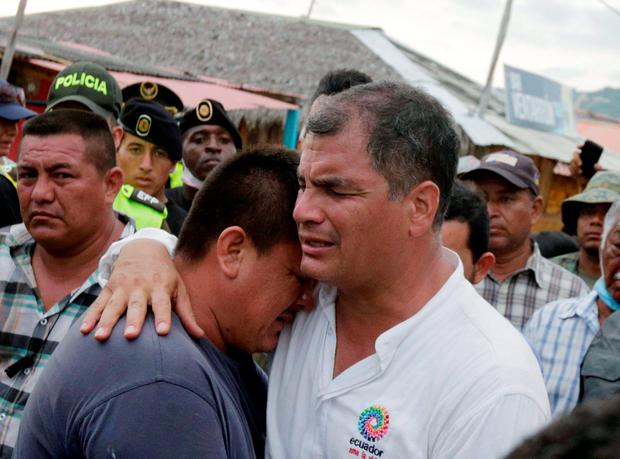 Ecuador's President Rafael Correa (R) embraces a resident after the earthquake, which struck off the Pacific coast, in the town of Canoa, Ecuador April 18, 2016