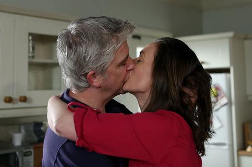 Tommy and Debbie share a passionate kiss in Fair City.