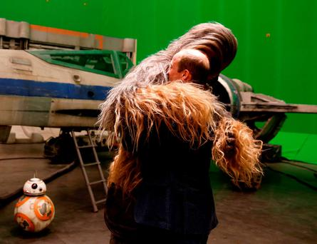 Britain's Prince William, Duke of Cambridge (R) is greeted by Chewbacca during a tour of the Star Wars sets at Pinewood studios in Iver Heath, west of London on April 19, 2016./ AFP PHOTO / ADRIAN DENNISADRIAN DENNIS/AFP/Getty Images