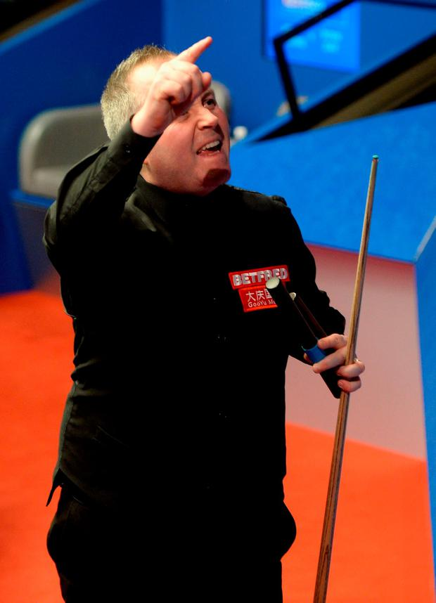 John Higgins celebrates. Photo: Getty