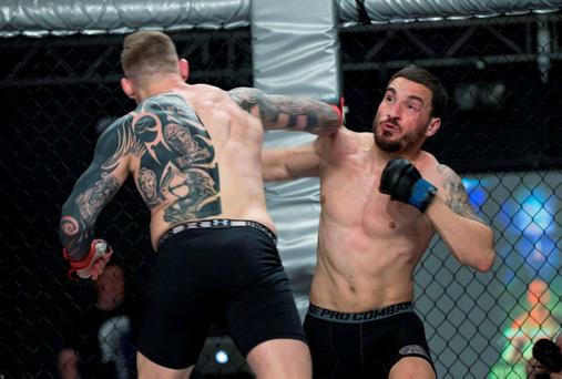 Portuguese MMA fighter Joao Carvalho (on right) during his bout with Charlie Ward. Photo: Dave Fogarty
