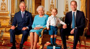 Prince George stands on foam blocks during a Royal Mail photoshoot for a stamp sheet to mark the 90th birthday of Queen Elizabeth II. The sheet features four generations of the Royal family, from left, the Prince of Wales, Queen Elizabeth II, Prince George and the Duke of Cambridge, and the picture was taken in the summer of 2015 in the White Drawing Room at Buckingham Palace. Photo: Ranald Mackechnie/Royal Mail/PA Wire
