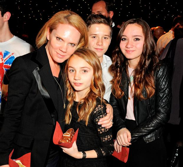 Louise Adams (L) with daughters Liberty and Tallulah and Brooklyn Beckham (2R) attend an after party celebrating the Gala Press Night performance of 'Viva Forever' at Victoria Embankment Gardens on December 11, 2012 in London, England. (Photo by Dave M. Benett/Getty Images)