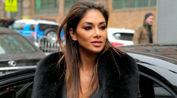 Singer Nicole Scherzinger arrives to the Jeremy Scott Fall 2016 fashion show in a Lexus during New York Fashion Week: The Shows at Moynihan Station on February 15, 2016 in New York City. (Photo by Jason Carter Rinaldi/Getty Images for Lexus)