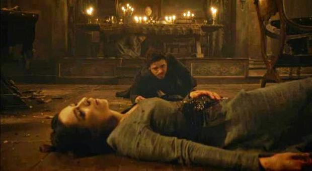 Robb Stark tries to protect his dying wife. Photo: Game of Thrones / HBO