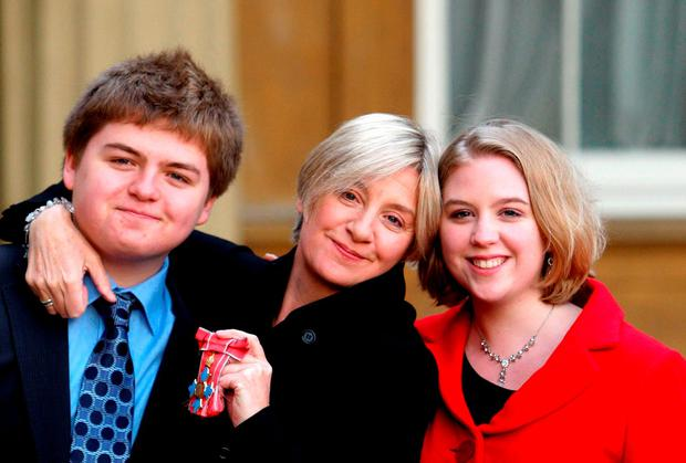 File photo dated 30/10/08 of Victoria Wood with children Henry and Grace Durham after receiving her CBE at Buckingham Palace, London Steve Parsons/PA Wire