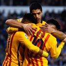 LA CORUNA, SPAIN - APRIL 20: Luis Suarez of FC Barcelona embraces his team mates Neymar (L) and Lionel Messi of FC Barcelona after Neymar scores his team's eighth goal during the La Liga match between RC Deportivo La Coruna and FC Barcelona at Riazor Stadium on April 20, 2016 in La Coruna, Spain. (Photo by David Ramos/Getty Images)