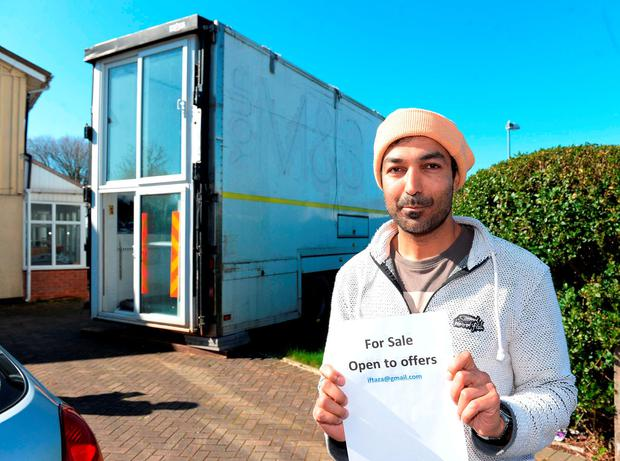 Iftikhar Azam outside his mother's home in Sheldon, Birmingham where he parked a lorry trailer fitted out as living accommodation. Matthew Cooper/PA Wire