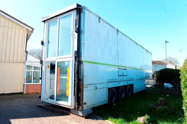 The lorry trailer belonging to Iftikhar Azam outside his mother's home in Sheldon, Birmingham which has been fitted out as living accommodation. Matthew Cooper/PA Wire