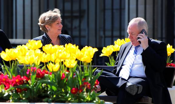 Acting Minister for Justice Frances Fitzgerald and acting junior minister for Sport Michael Ring on the plinth at Leinster House yesterday during a break in government negotiations. Photo: Tom Burke