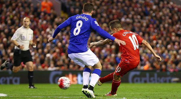 LIVERPOOL, ENGLAND - APRIL 20: Philippe Coutinho of Liverpool scores his sides fourth goal during the Barclays Premier League match between Liverpool and Everton at Anfield, April 20, 2016, Liverpool, England (Photo by Clive Brunskill/Getty Images)