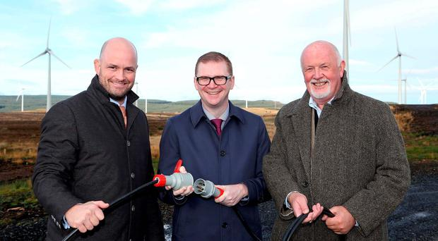Patrick McClughan and Brendan McGrath of Gaelectric with Northern Ireland minister Simon Hamilton (centre)