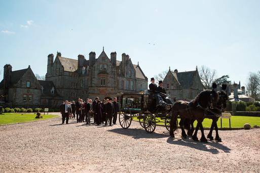 The horsedrawn carriage carrying the coffin of Sir Jack Leslie. Photo: Philip Fitzpatrick.