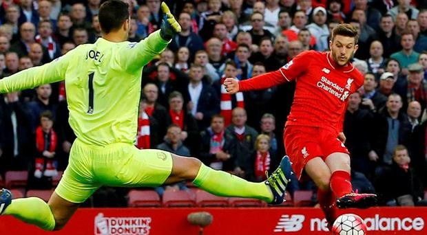 Everton goalkeeper Joel Robles saves Adam Lallana's early effort at Anfield. Photo: Andrew Yates/Reuters