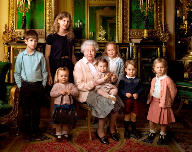 Royal portrait by US photographer Annie Liebovitz shows Queen Elizabeth with her two grandchildren, James, Viscount Severn (left) and Lady Louise (second left) and her five great-grandchildren Mia Tindall (holding handbag), Savannah Philipps (third right), Isla Phillips (right), Prince George (second right) and Princess Charlotte (centre) in the Green Drawing room at Windsor Castle Photo: AFP PHOTO / 2016 ANNIE LIEBOVITZ