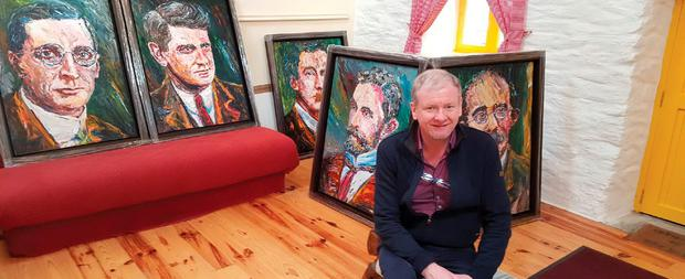 Artist Liam O'Neill with his portraits of the 1916 Easter Rising patriots