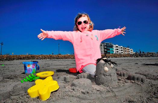 Aryia Pringle from Belfast (above) enjoys the fine spell of weather in Salthill, Galway. Photo: Declan Monaghan