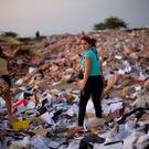Women comb through a post-earthquake debris field to salvage recyclable materials, in Manta, Ecuador. (AP Photo/Rodrigo Abd)