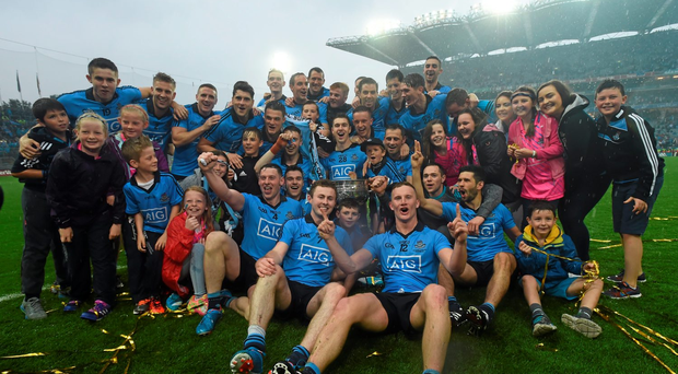 Dublin players celebrate with the Sam Maguire Cup