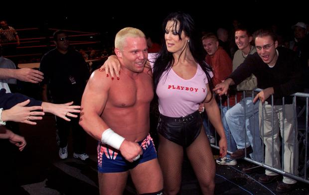 Crash (left) walks off the runway arm in arm with Chyna