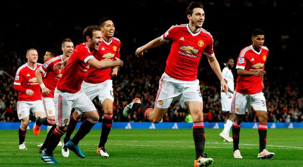 Matteo Darmian celebrates after scoring the second goal for Manchester United