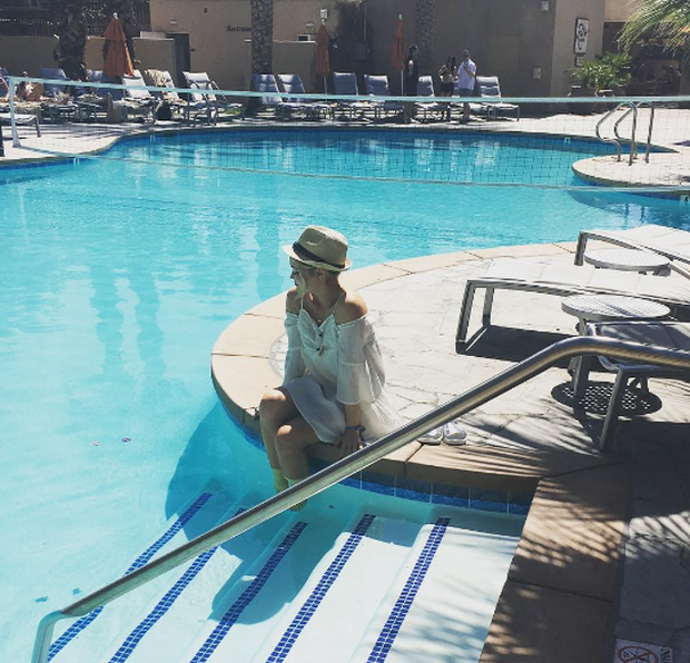 Laura Whitmore relaxes poolside on her Californian vacation. Photo: Instagram