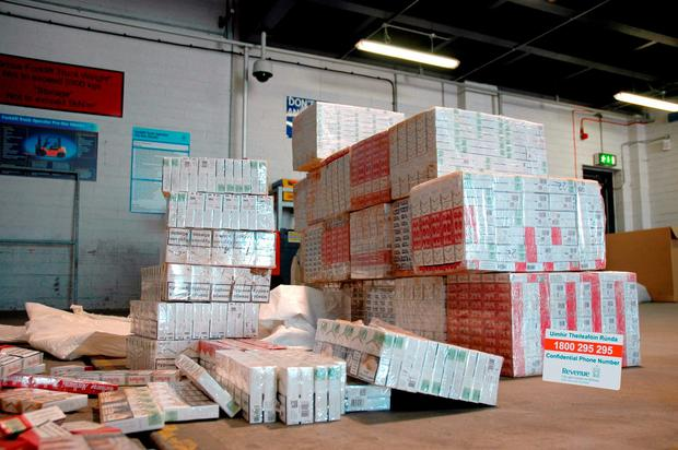 Around 250,000 illegal cigarettes that were found hidden under a cargo of farm machinery by Customs sniffer dog Casey Credit: Revenue & Customs/PA Wire