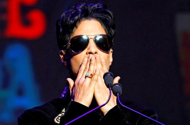 Singer Prince gestures as he announces upcoming live dates at the Apollo Theater in New York October 14, 2010. REUTERS/Lucas Jackson/Files