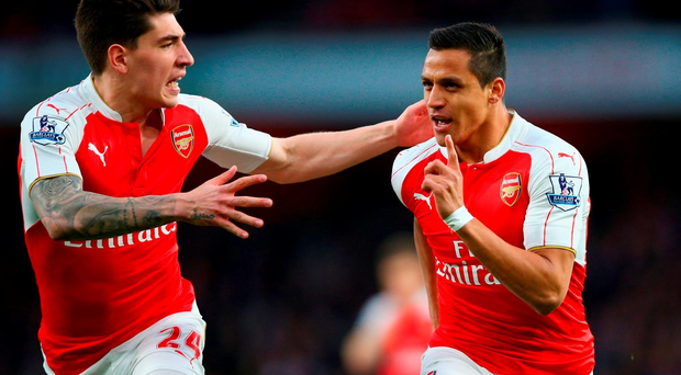 LONDON, ENGLAND - APRIL 21: Alexis Sanchez of Arsenal (R) celebrates with Hector Bellerin as he scores their first goal during the Barclays Premier League match between Arsenal and West Bromwich Albion at the Emirates Stadium on April 21, 2016 in London, England. (Photo by Paul Gilham/Getty Images)