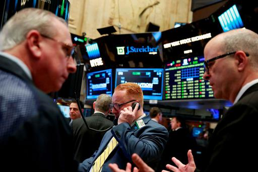 Traders work on the floor of the New York Stock Exchange shortly after the opening bell in New York. Photo: Reuters