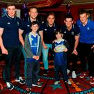 Leinster's Garry Ringrose, David O'Connor, Oisin Heffernan, Tom Daly andJosh van der Flier, pose for a photo with Don and Joey Mulgair, from Blackrock, as Leinster Rugby hosted A Night At The Movies in aid of The Alzheimer Society of Ireland Photo: Sportsfile