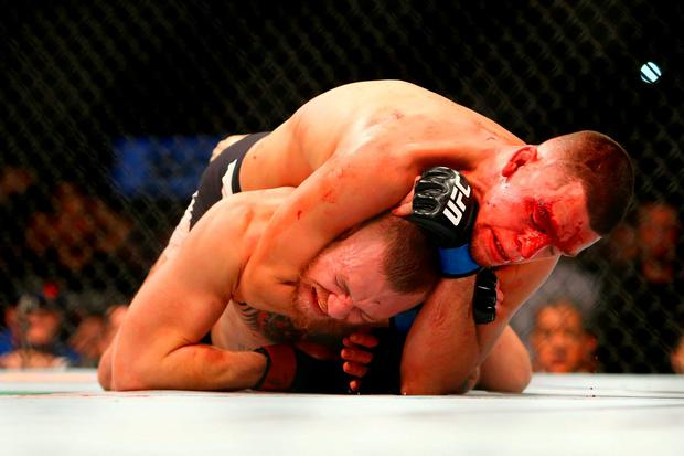 Conor McGregor submits to a choke-hold by Nate Diaz at UFC 196 in Las Vegas last month. Photo: Getty Images