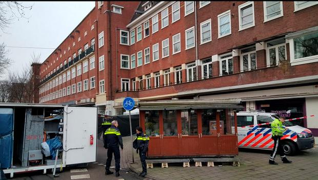 The scene at the Fayrouz Lounge in Amsterdam where the victim's severed head was found in a bucket outside a cafe