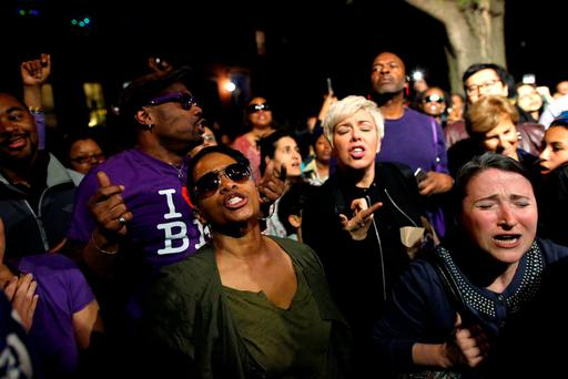 People dance at a street party hosted by director Spike Lee called