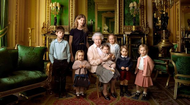 Queen Elizabeth II (C) posing with her two grandchildren, James, Viscount Severn (L) and Lady Louise (2L) and her five great-grandchildren Mia Tindall (holding handbag), Savannah Philipps (3R), Isla Phillips (R), Prince George (2R) and Princess Charlotte (C) in the Green Drawing room at Windsor Castle in Windsor. Picture: ANNIE LEIBOVITZ/AFP/Getty Images