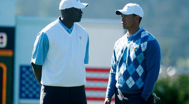Michael Jordan chats with Tiger Woods