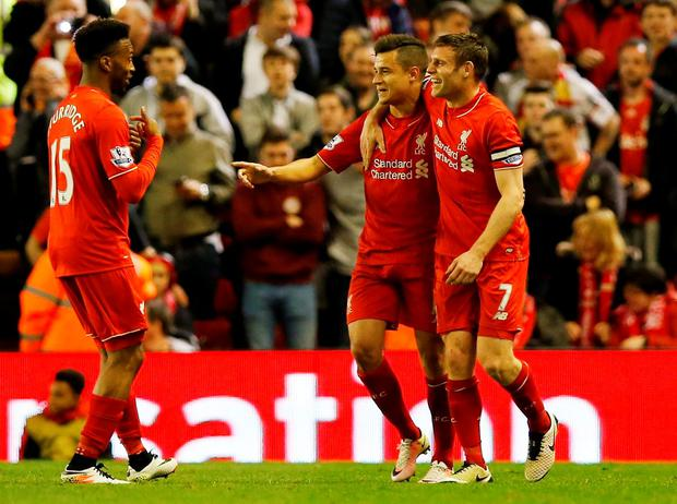 Philippe Coutinho celebrates after scoring the fourth goal for Liverpool