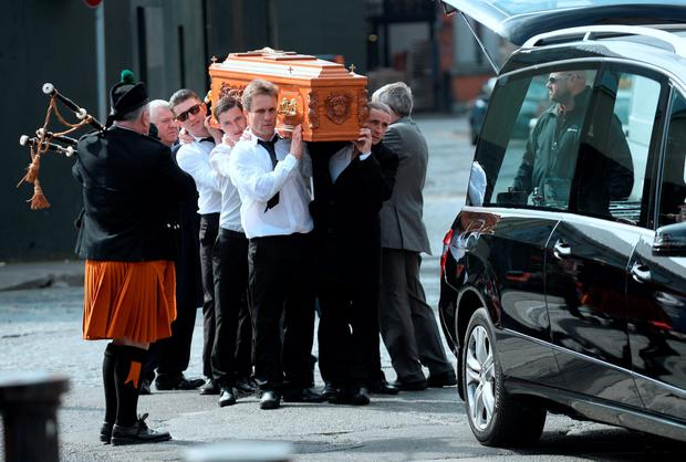 General view of coffin being taken from the hearse and carried to church. Funeral of Martin O'Rourke. St Michans Church, Halston Streett, Dublin. Picture: Caroline Quinn