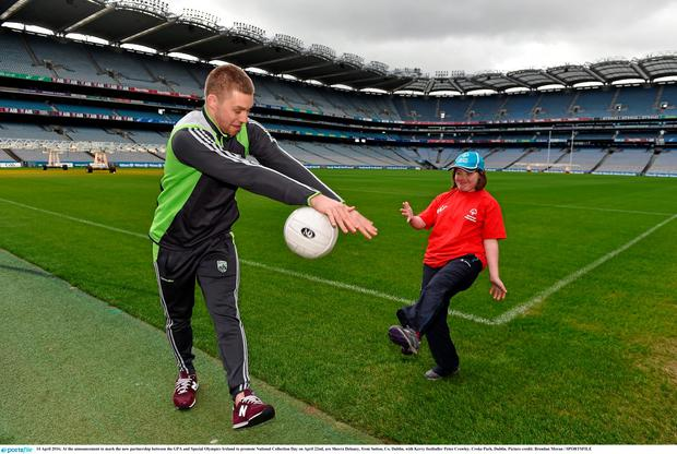 At the announcement to mark the new partnership between the GPA and Special Olympics Ireland to promote National Collection Day on April 22nd, are Sheera Delaney, from Sutton, Co. Dublin, with Kerry footballer Peter Crowley. Croke Park, Dublin. Picture credit: Brendan Moran / SPORTSFILE