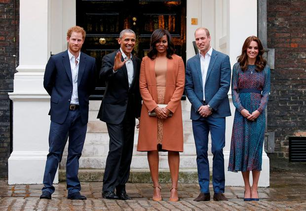 U.S. President Barack Obama and first lady Michelle Obama pose with Britain's Prince William, Kate, and Prince Harry, upon arrival for dinner at Kensington Palace. Reuters/Kevin Lamarque
