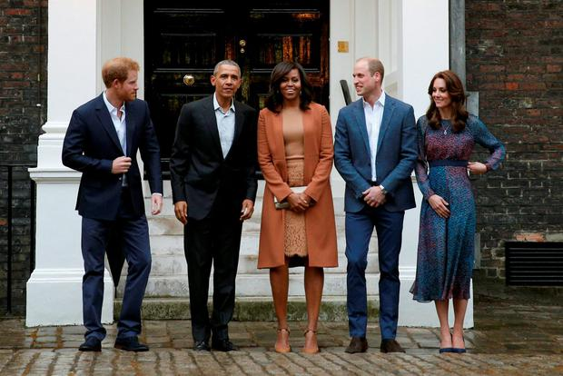 U.S. President Barack Obama and first lady Michelle Obama pose with Kate, William and Harry at Kensington Palace. Reuters/Kevin Lamarque