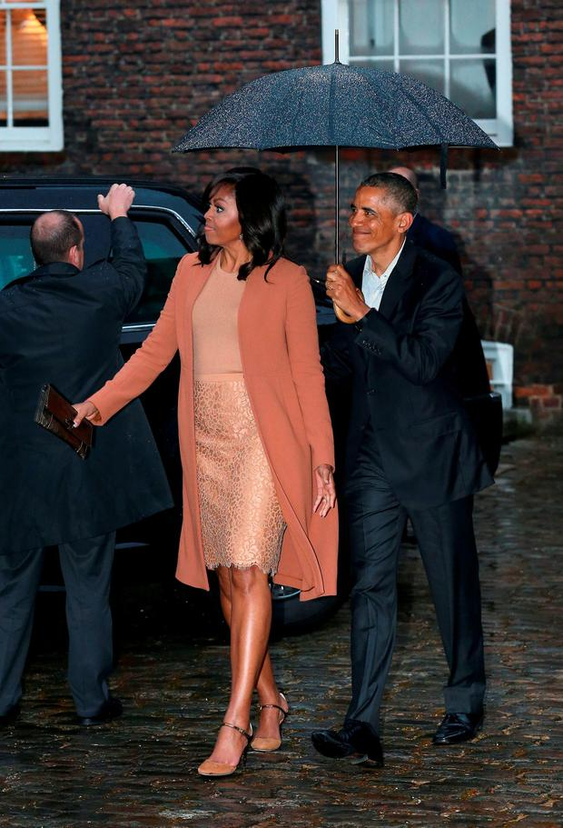 The President and First Lady of the United States Barack Obama and his wife Michelle arrive at Kensington Palace. Photo: Chris Radburn/PA Wire