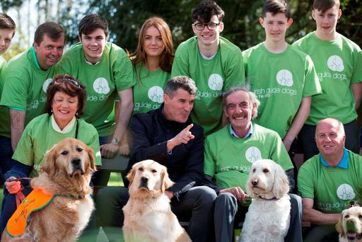 Roy Keane with Igor the dog chatting to Irish Guide Dogs volunteer Jim Leahy and his dog Ube at the launch of the fundraising campaign yesterday. Photo: Clare Keogh
