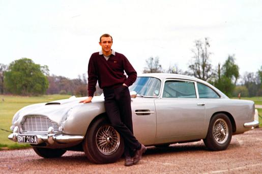 Sean Connery with the legendary Aston Martin DB5 in Goldfinger