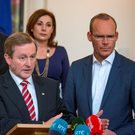Taoiseach Enda Kenny with Josepha Madigan TD and acting Minister for Agriculture Simon Coveney at Government Buildings following talks between Fine Gael and a number of Independent deputies on forming a new government. Photo: Arthur Carron