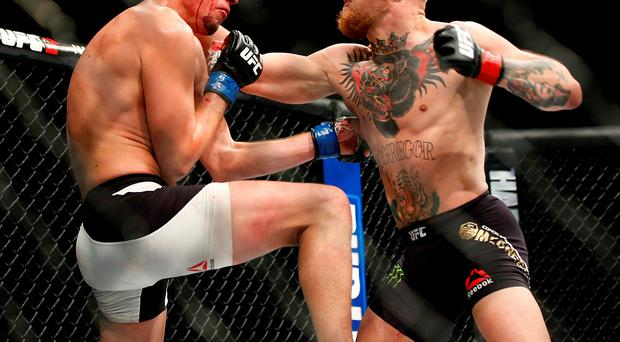 Conor McGregor, right, trades punches with Nate Diaz during their UFC 196 welterweight mixed martial arts match in Las Vegas. Conor McGregor has packed a punch on social media rather than inside a UFC cage. (AP Photo/Eric Jamison, File)