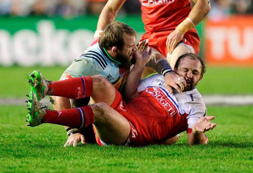Joe Marler of Harlequins clashes with Grenoble's Arnaud Hzguy Photo: Reuters / Henry Browne