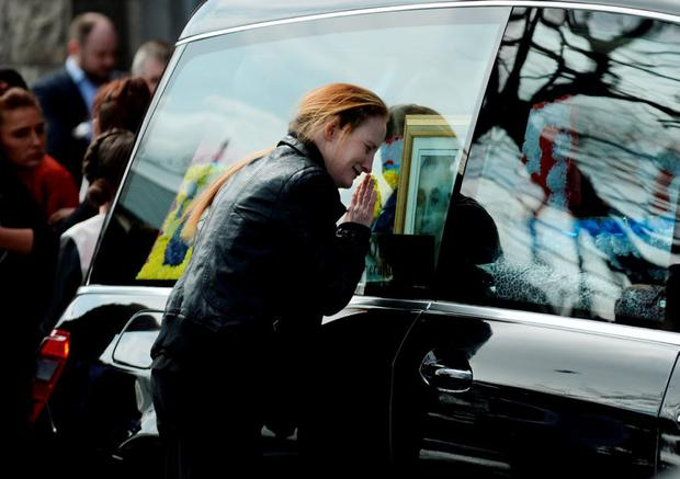 Martin O'Rourke's fiancee Angelina Power leans against the hearse containing his body. Photo: Caroline Quinn