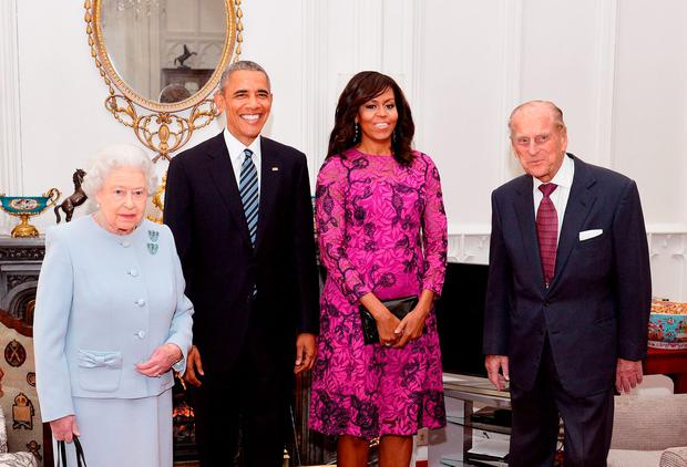 April 2016: Queen Elizabeth II (L) and Prince Philip, Duke of Edinburgh (R) stand with US President Barack Obama and First Lady of the United States, Michelle Obama in the Oak Room at Windsor Castle.